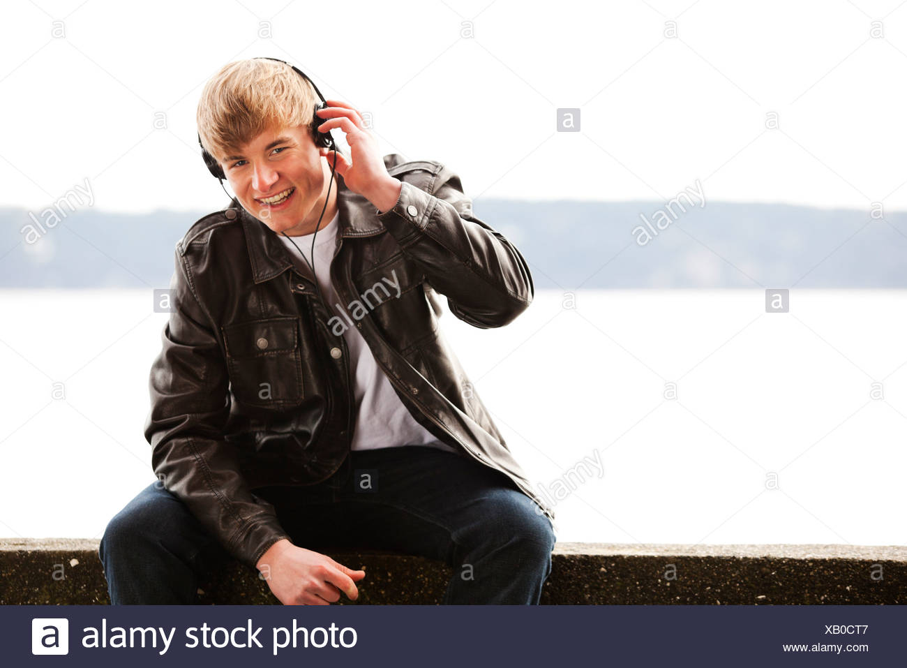 A man listens to headphones. - Stock Image