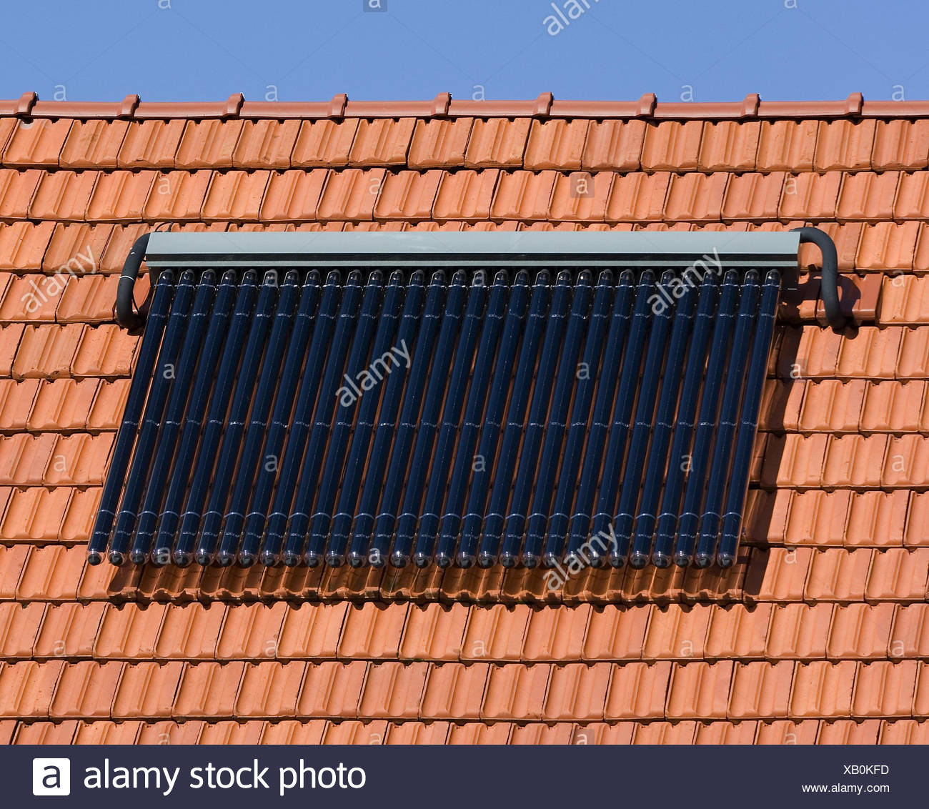 House roof, detail, solar panels, hot-water production, alternatively, alternative energy, water for industrial use, roof, tiled roof, roofing tile, energy, energy consumption, power supply, solar panel, solar collector, heat, hot water, water, climate, climate change, ecologically, - Stock Image