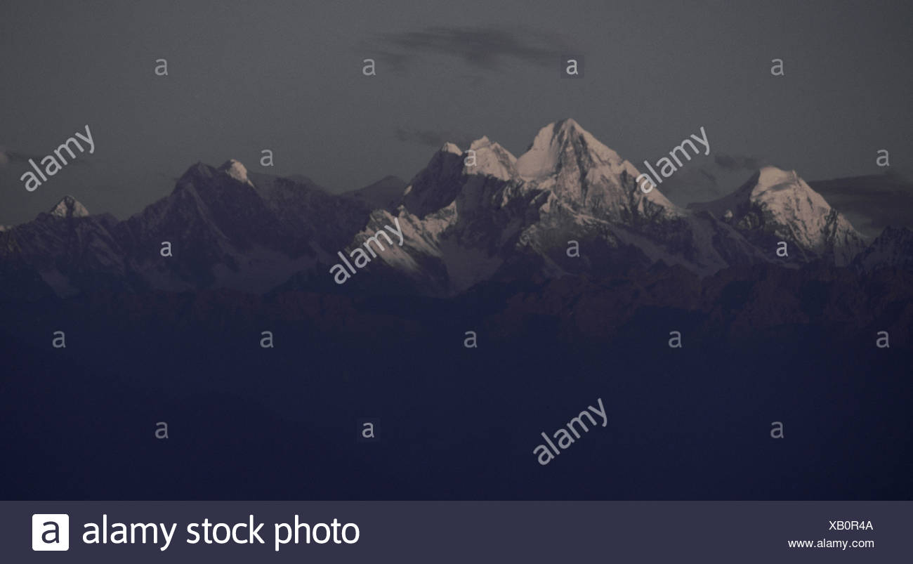 The Himalayan mountain chain caressed by the light of the setting sun. - Stock Image