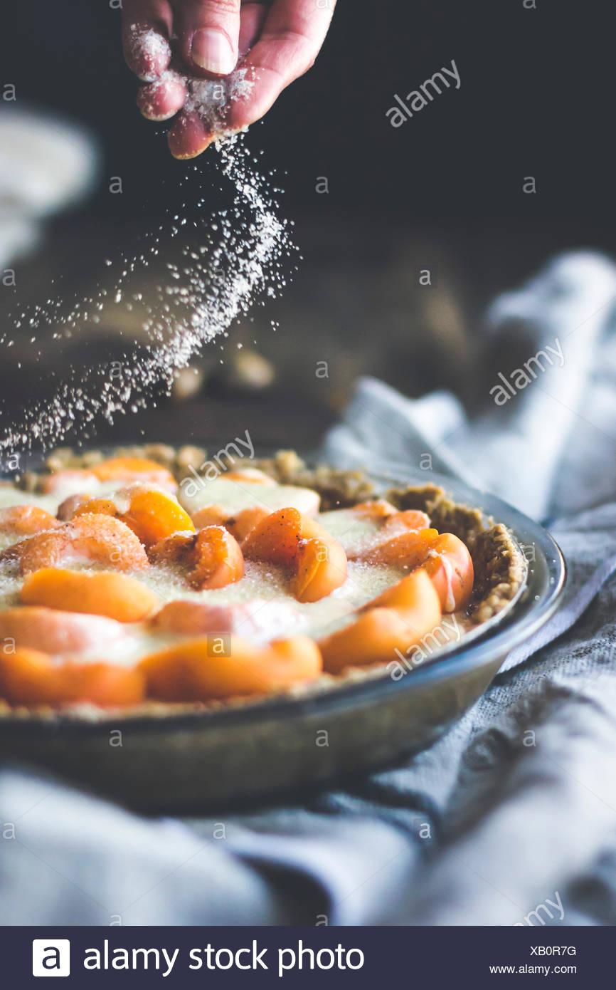 Apricot custard tart with crumble crust dessert Stock Photo