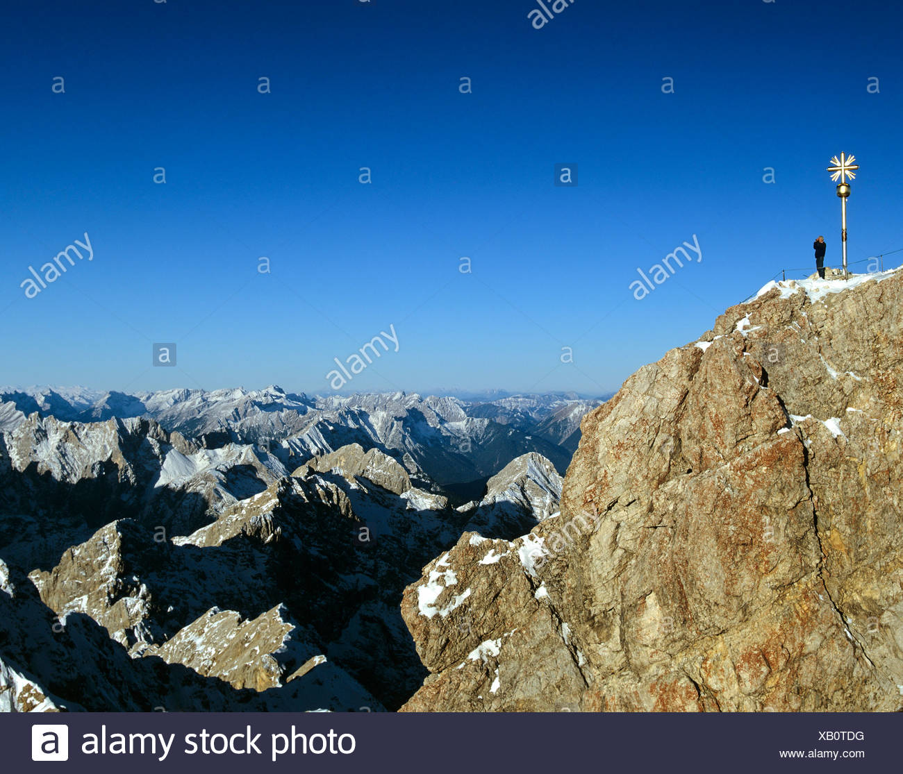 Summit cross at 2962 m or 9718 ft on the Zugspitze, Germany's highest mountain, Wetterstein Range, Werdenfels Region, Upper Bav - Stock Image