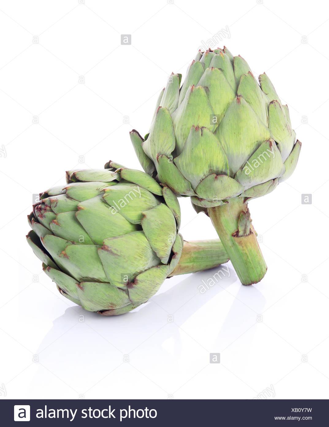 Ripe green artichoke vegetables isolated - Stock Image