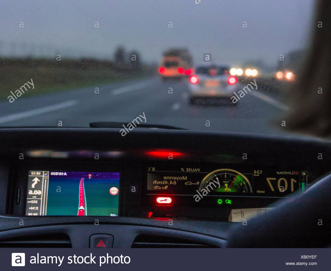 driving on a highway with a GPS. - Stock Image