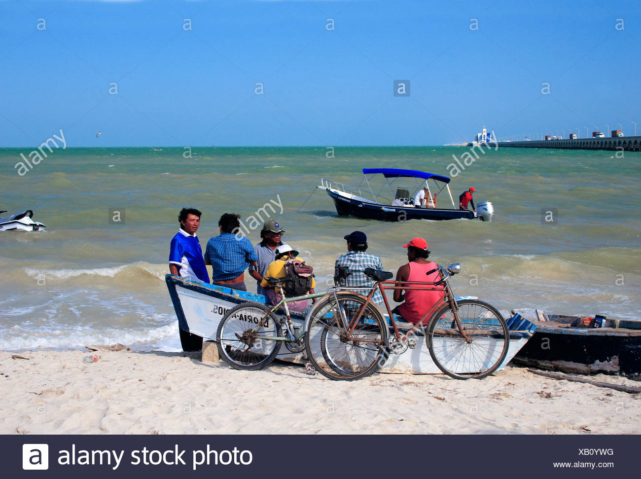 Beach ; Local people ; Bicycle ; Progresso ; Mexico - Stock Image