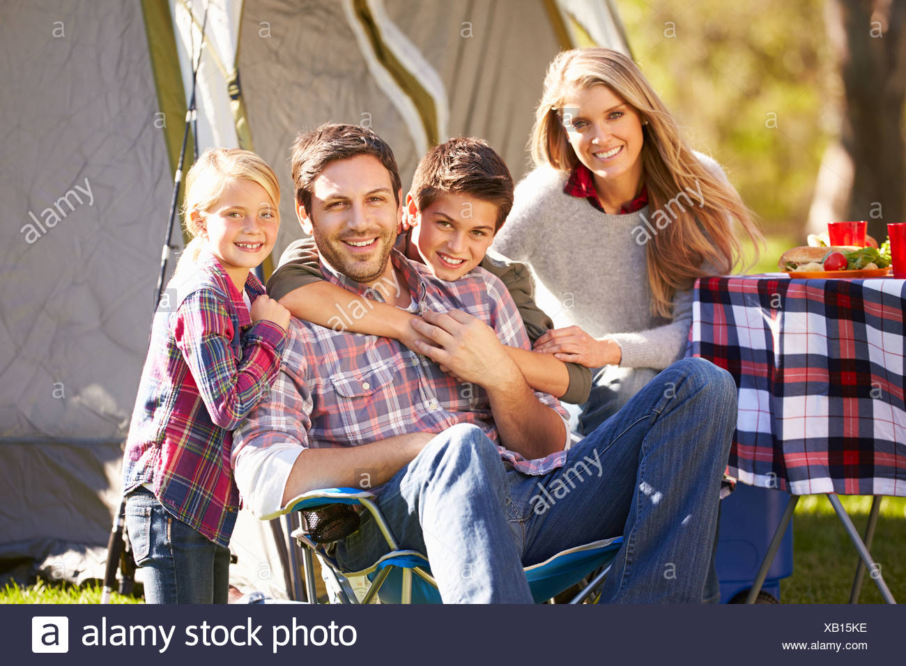 Family Enjoying Camping Holiday In Countryside - Stock Image