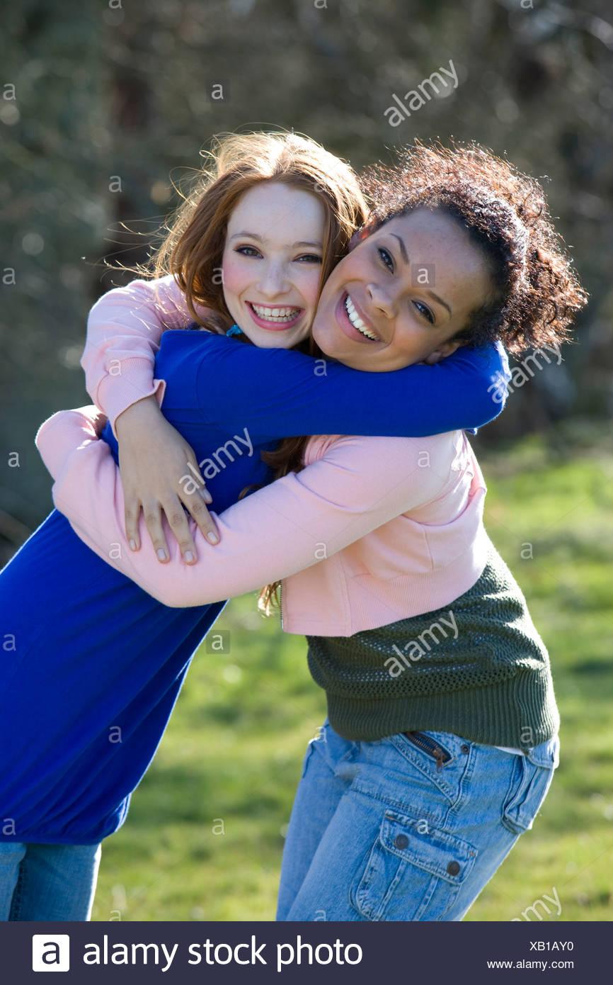 Friends hugging - Stock Image