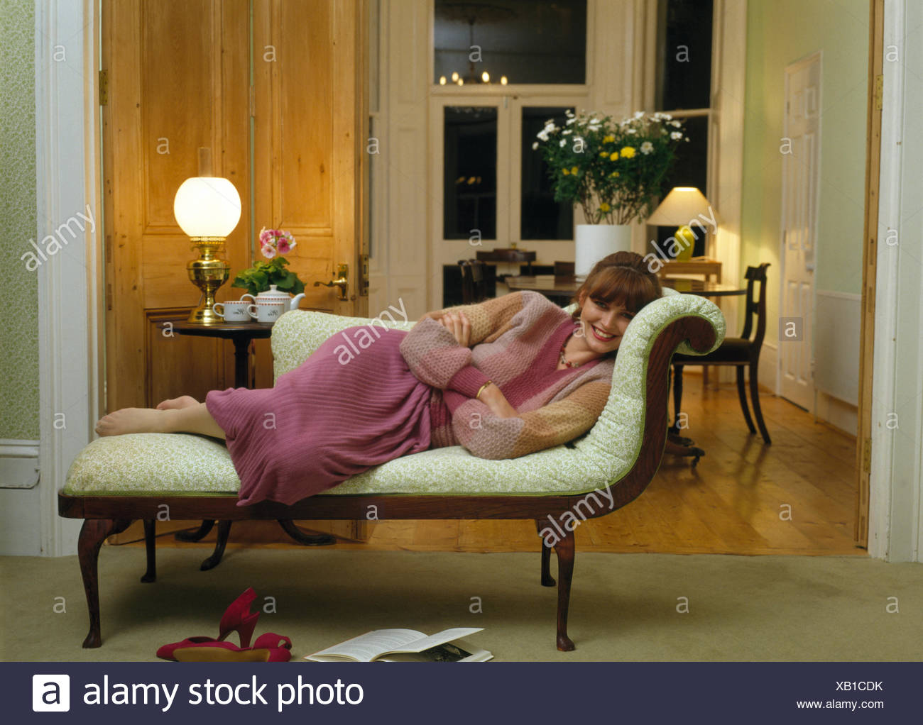 Young Woman Reclining On A Chaise Longue In A Seventies