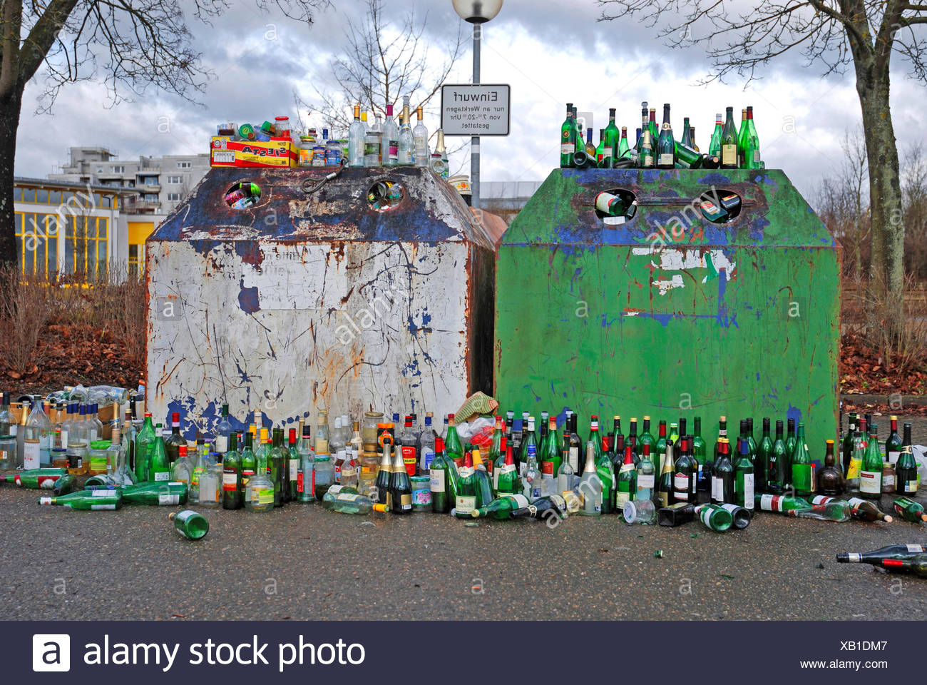 empty bottles around a abuzzed bottle bank, Germany Stock Photo