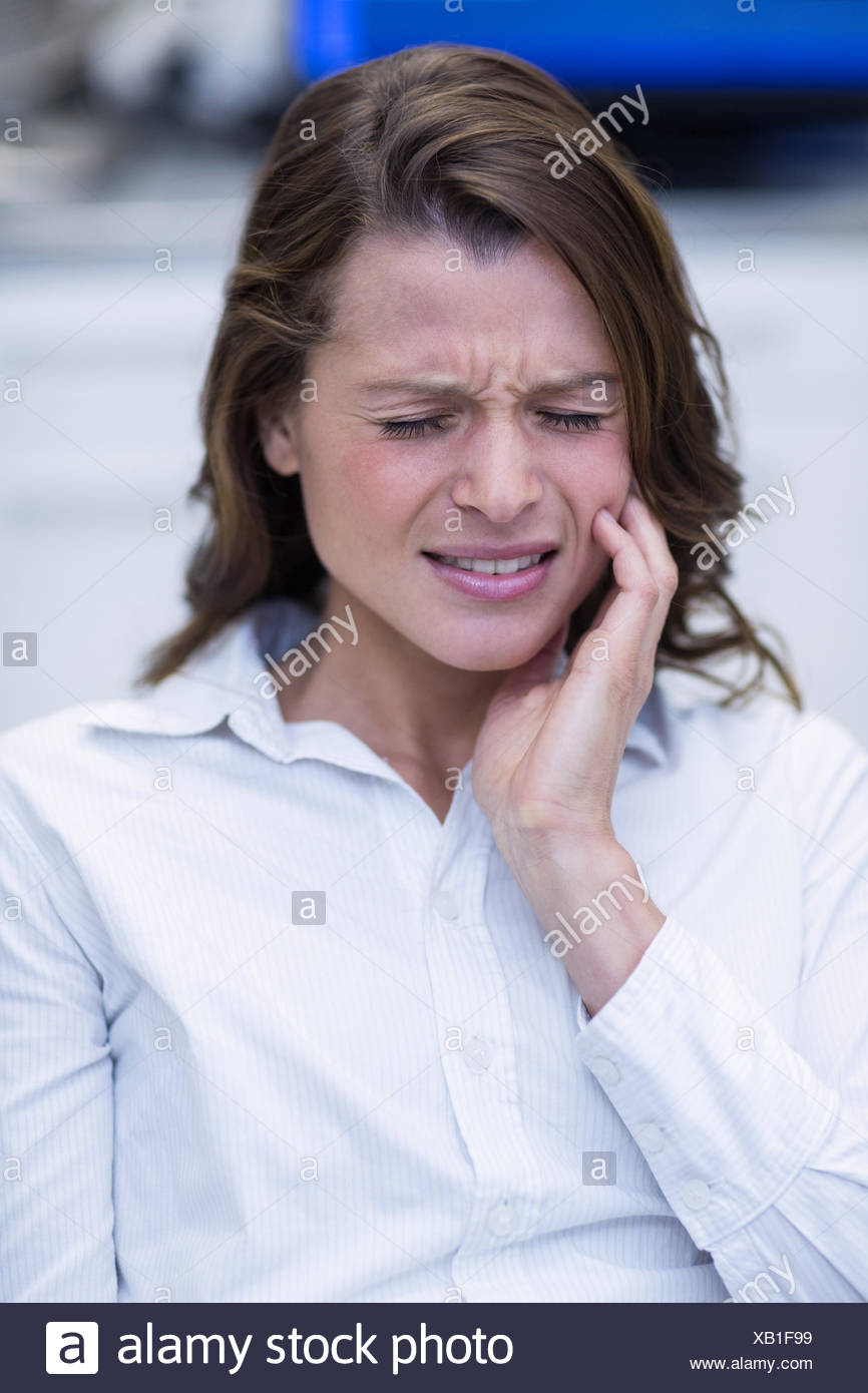 Woman suffering from toothache - Stock Image