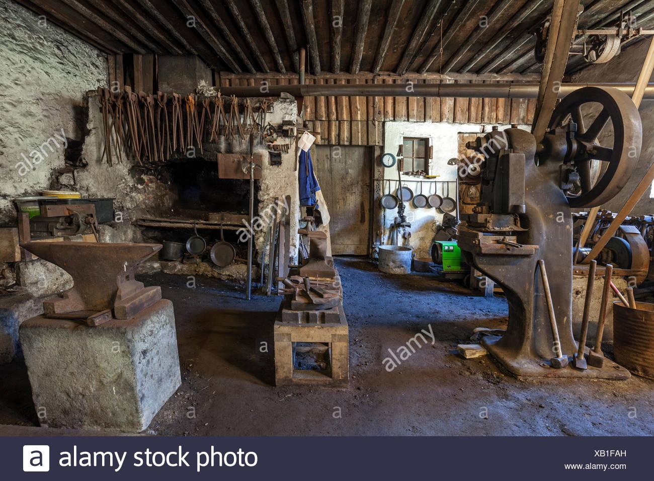 Interior, workshop, old hammer mill at the Ostrach, Obere Hammerschmiede, Bad Oberdorf in Bad Hindelang, Allgäu, Bavaria - Stock Image