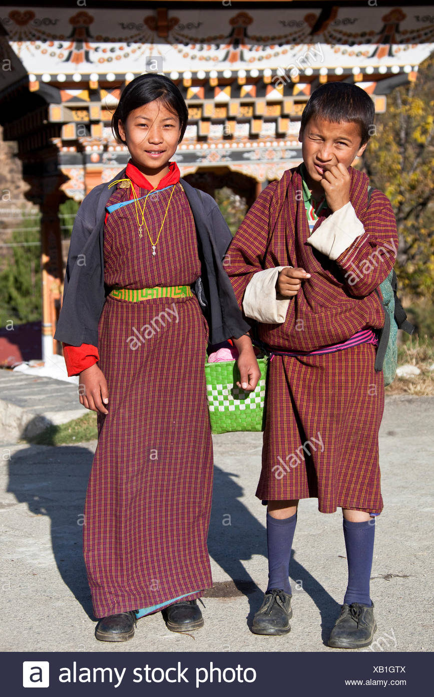 Children wearing gho and kira, national Bhutan dress for men and women, Bhutan, South Asia - Stock Image