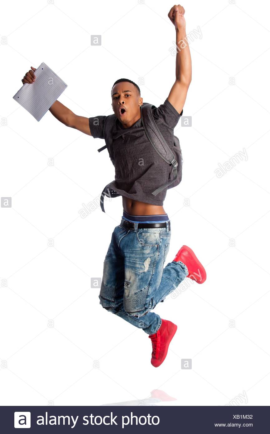Handsome student jumping because of good grades, on white. - Stock Image