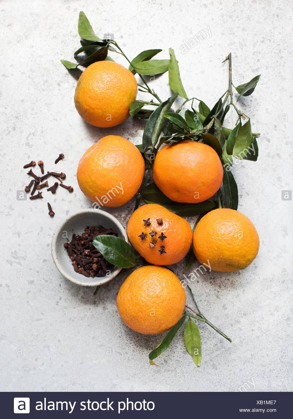 Overhead view of oranges decorated with cloves - Stock Image