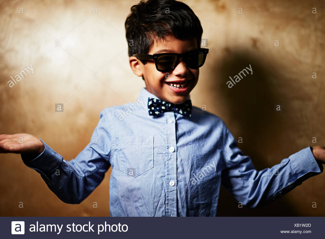 Boy wearing sunglasses and bow tie Stock Photo