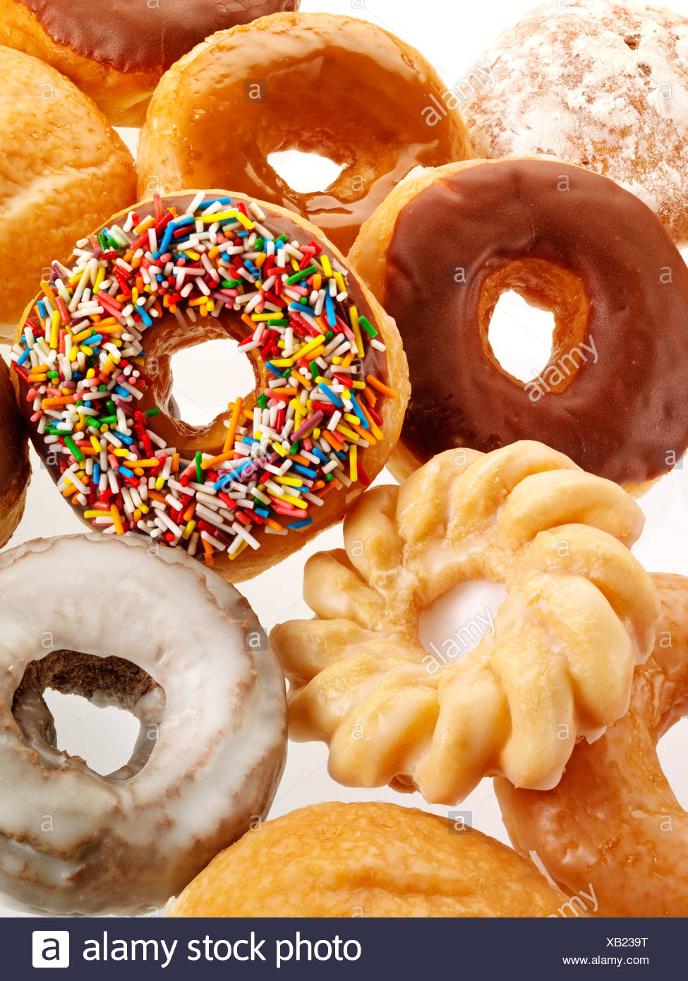 SELECTION OF DOUGHNUTS CUT OUT - Stock Image