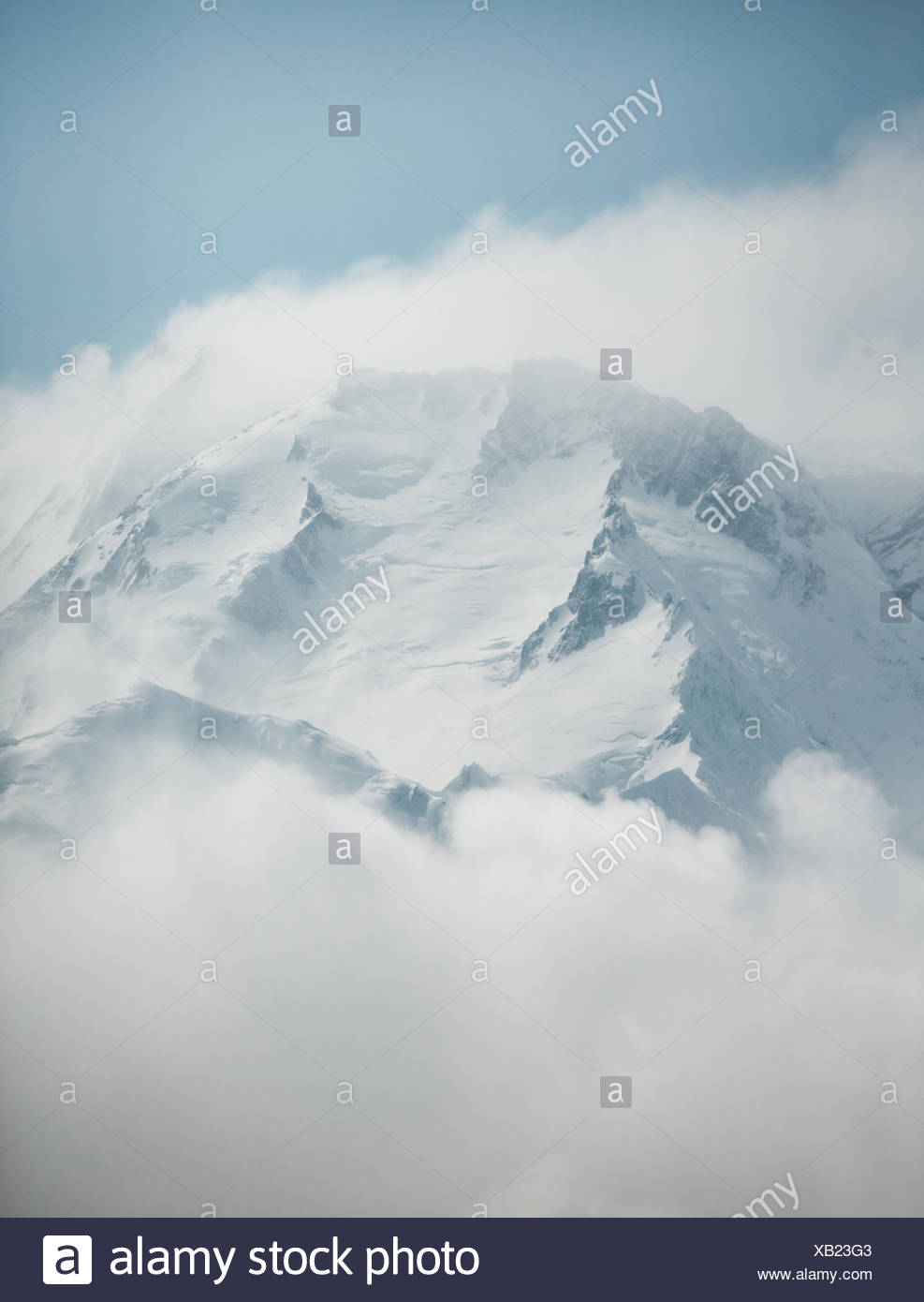 The peak of Nanga Parbat, 8,126 m or 26,660 ft, the world's 9th tallest mountain, emerges from cloud cover. - Stock Image