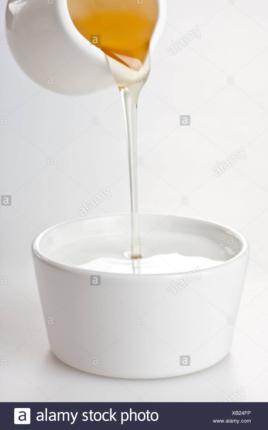 Honey Poured Into Yogurt Stock Photo