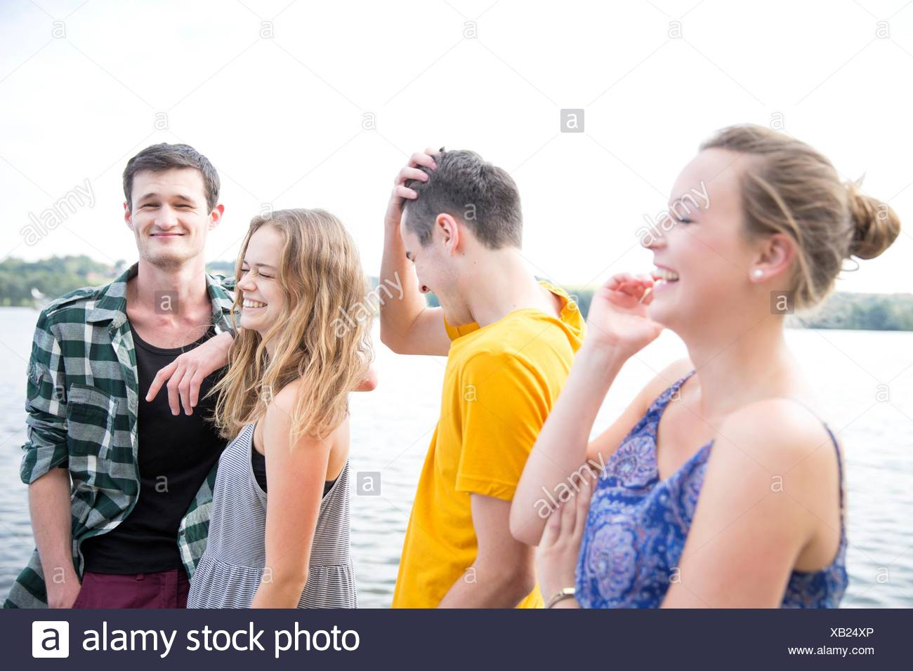 Group of young adults, outdoors, laughing Stock Photo