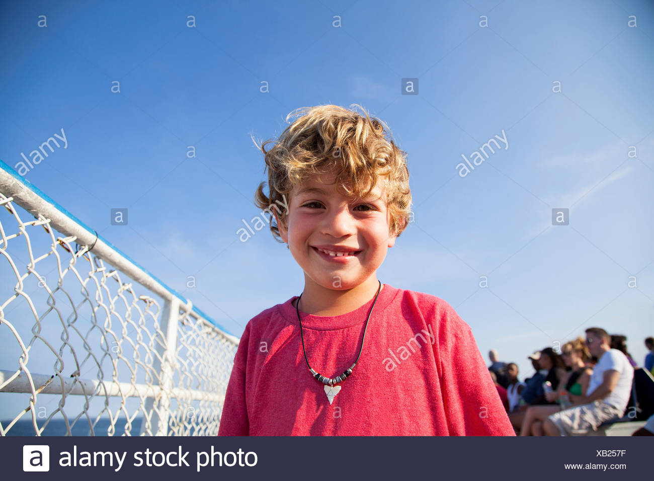 Portrait of blonde haired boy smiling - Stock Image