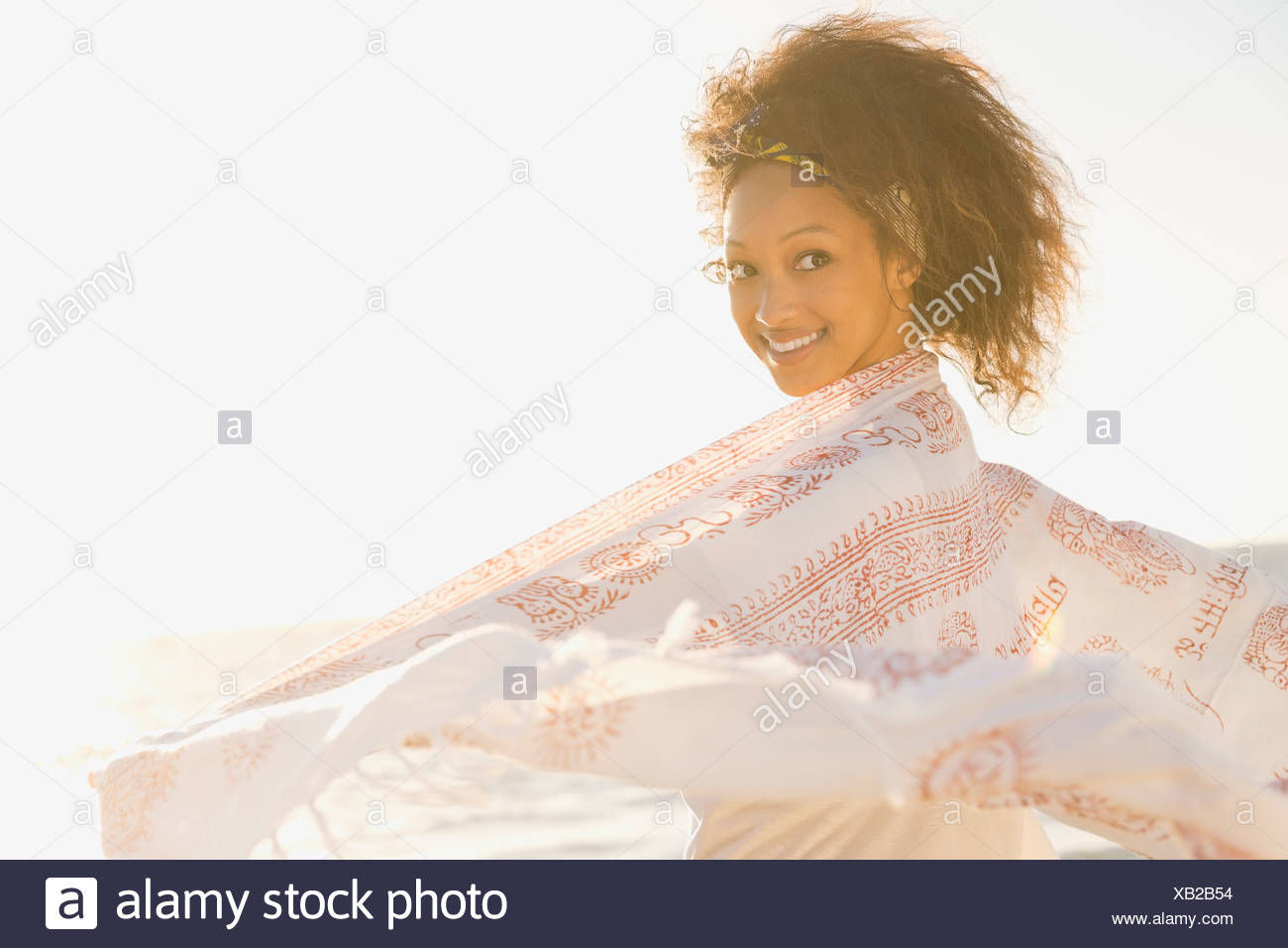 Woman with shawl on beach - Stock Image