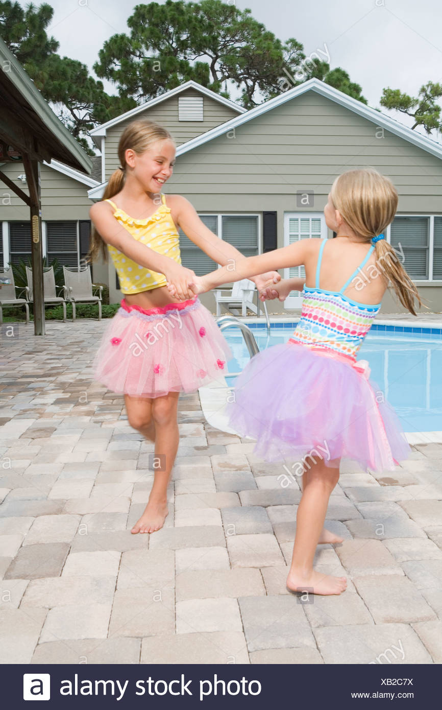 dfc78348e Girls in tutus playing by swimming pool Stock Photo: 282180638 - Alamy