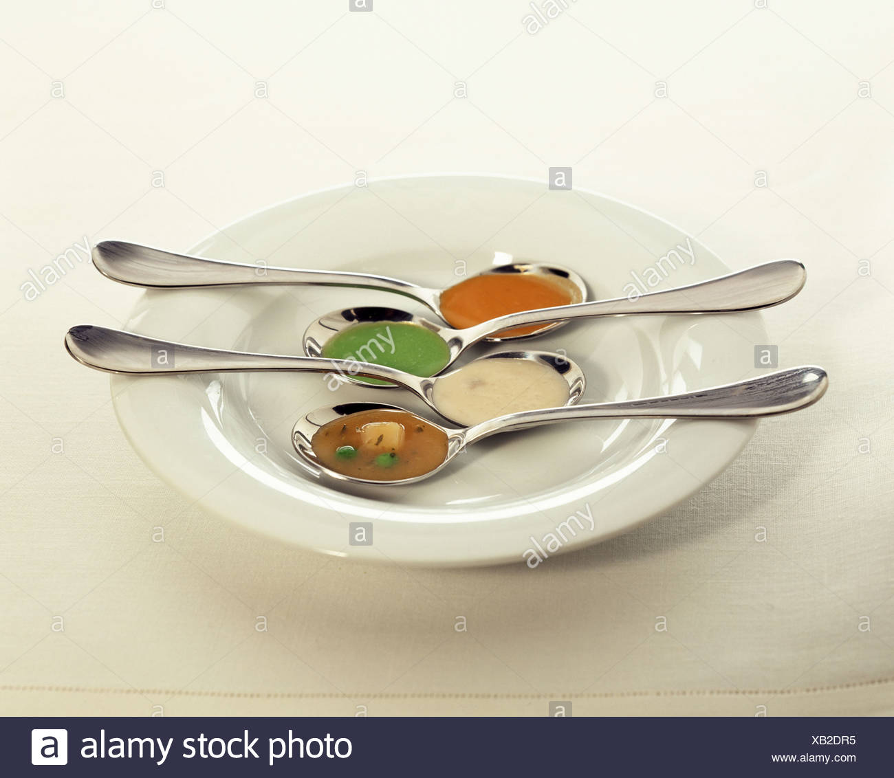spoonfuls of soup - Stock Image
