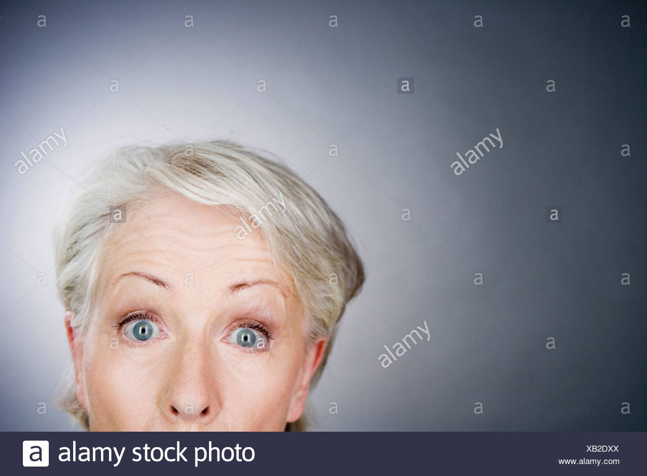 A senior woman looking surprised - Stock Image