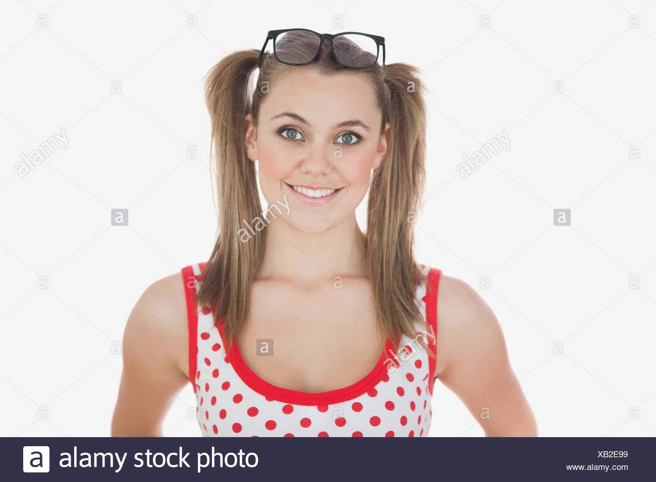 Young woman with long ponytails - Stock Image