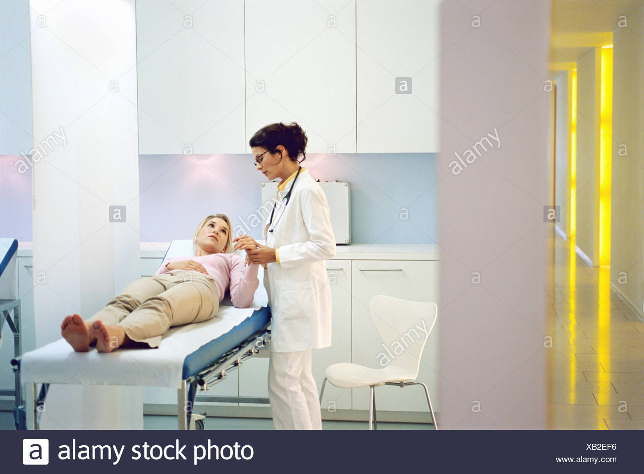 View of a female patient being examined by a female doctor - Stock Image