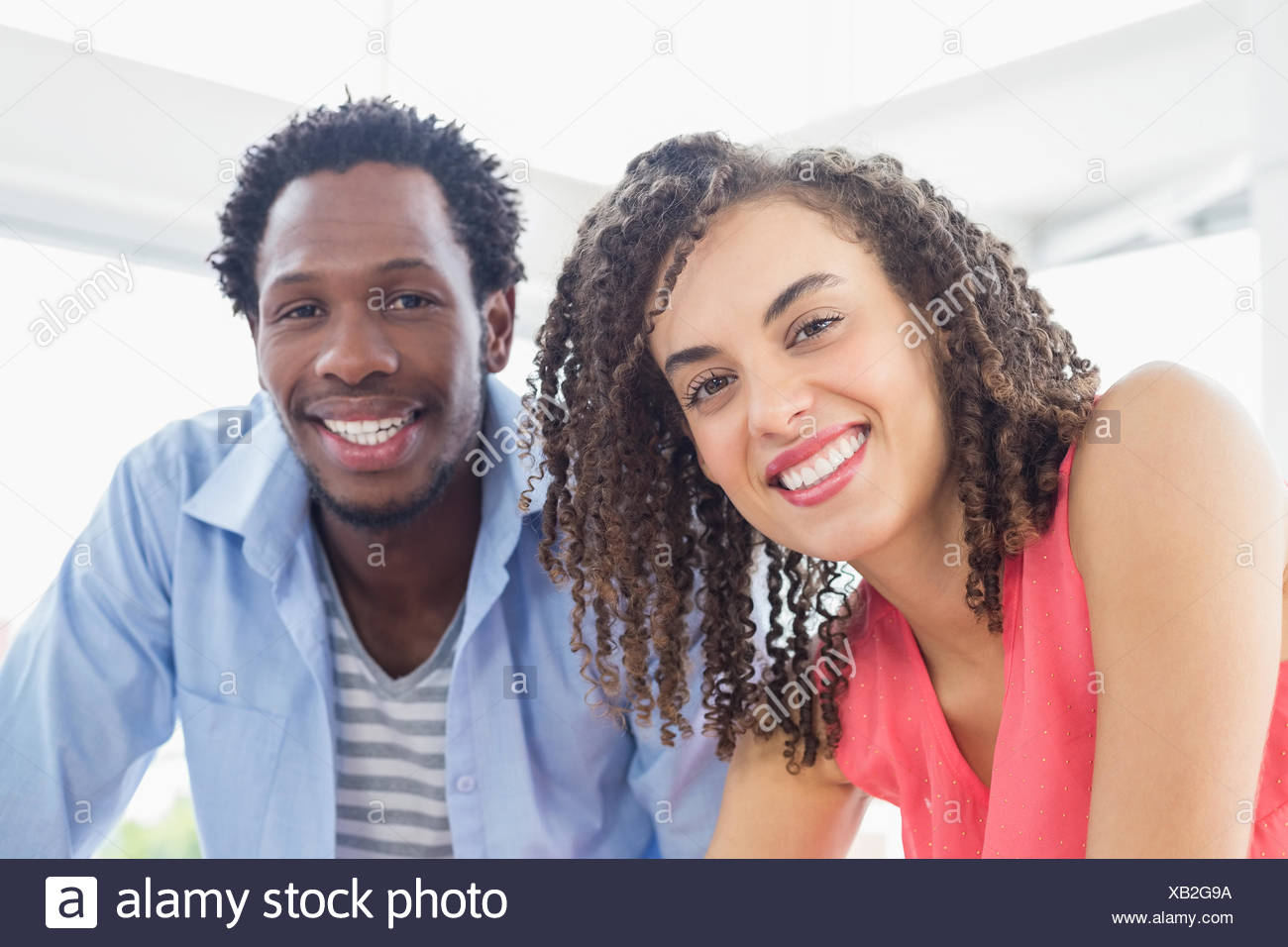 Two creative business colleagues looking at the camera - Stock Image