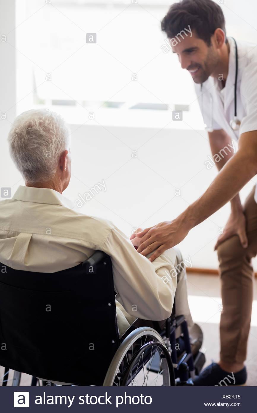 Nurse taking care of a senior man - Stock Image