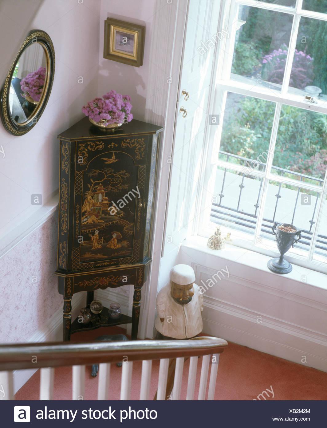 Antique oriental corner cupboard besidew window on small landing - Stock  Image - Oriental Antique Furniture Stock Photos & Oriental Antique Furniture