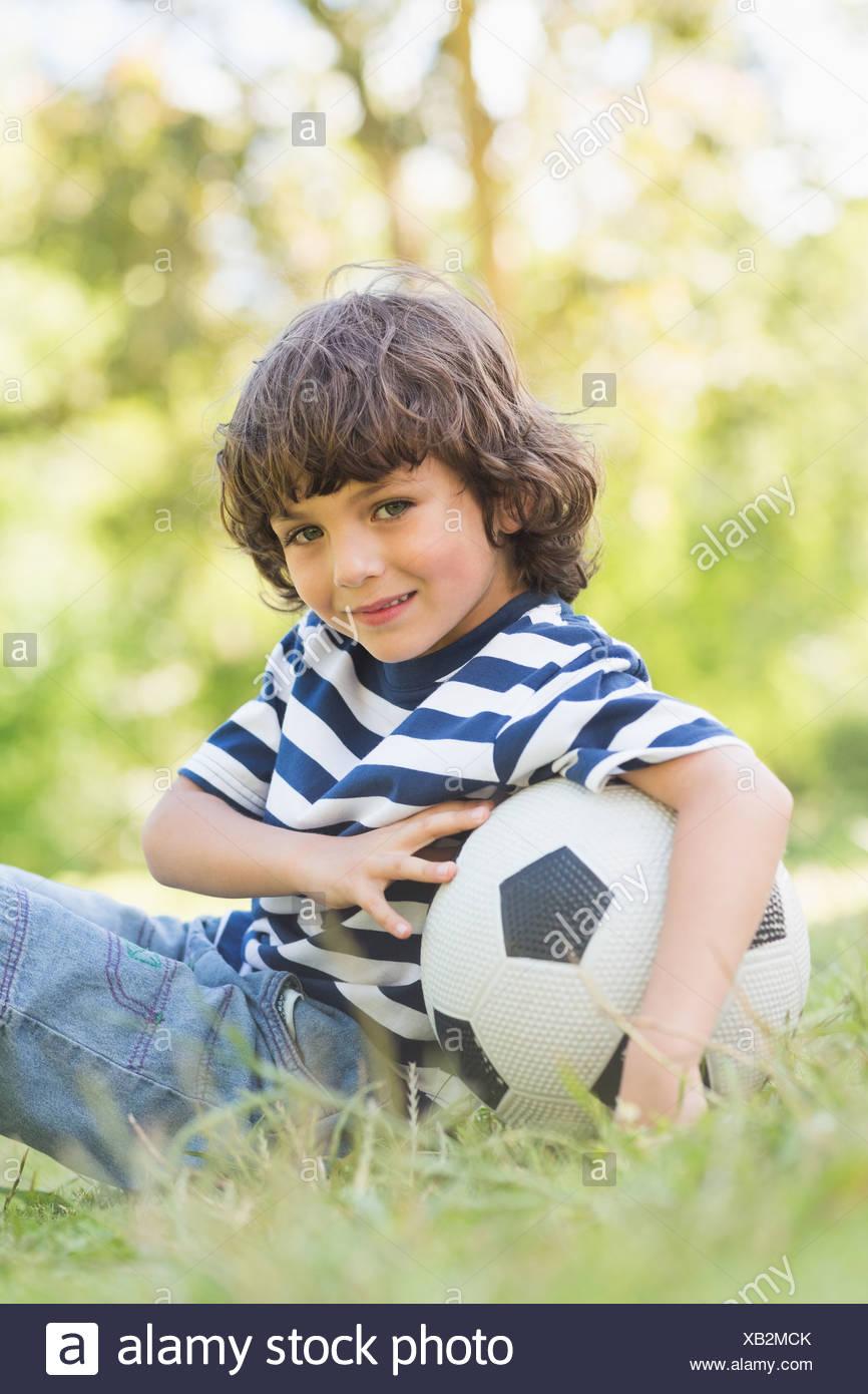 Little Boy Sitting In Grass Stock Photos & Little Boy