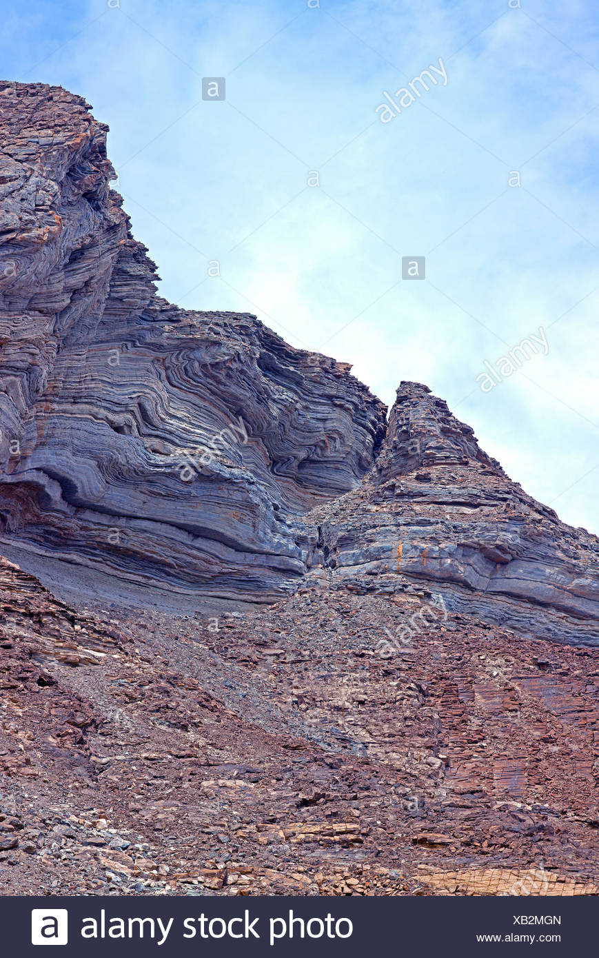 Cliff face with wave-shaped rejections, Damaraland, Namibia - Stock Image