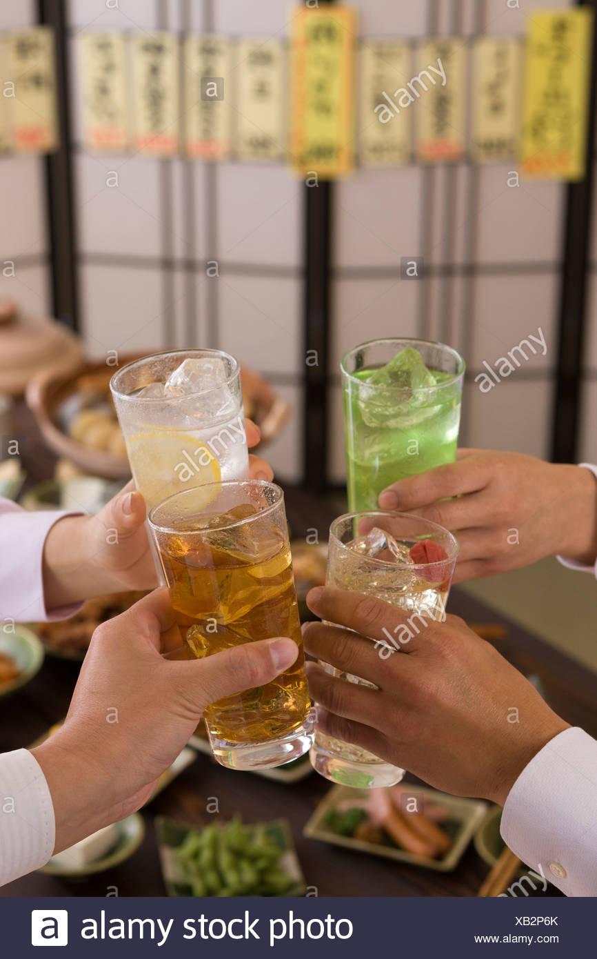 Four People Toasting with Various Chu-Hi at Izakaya Stock Photo