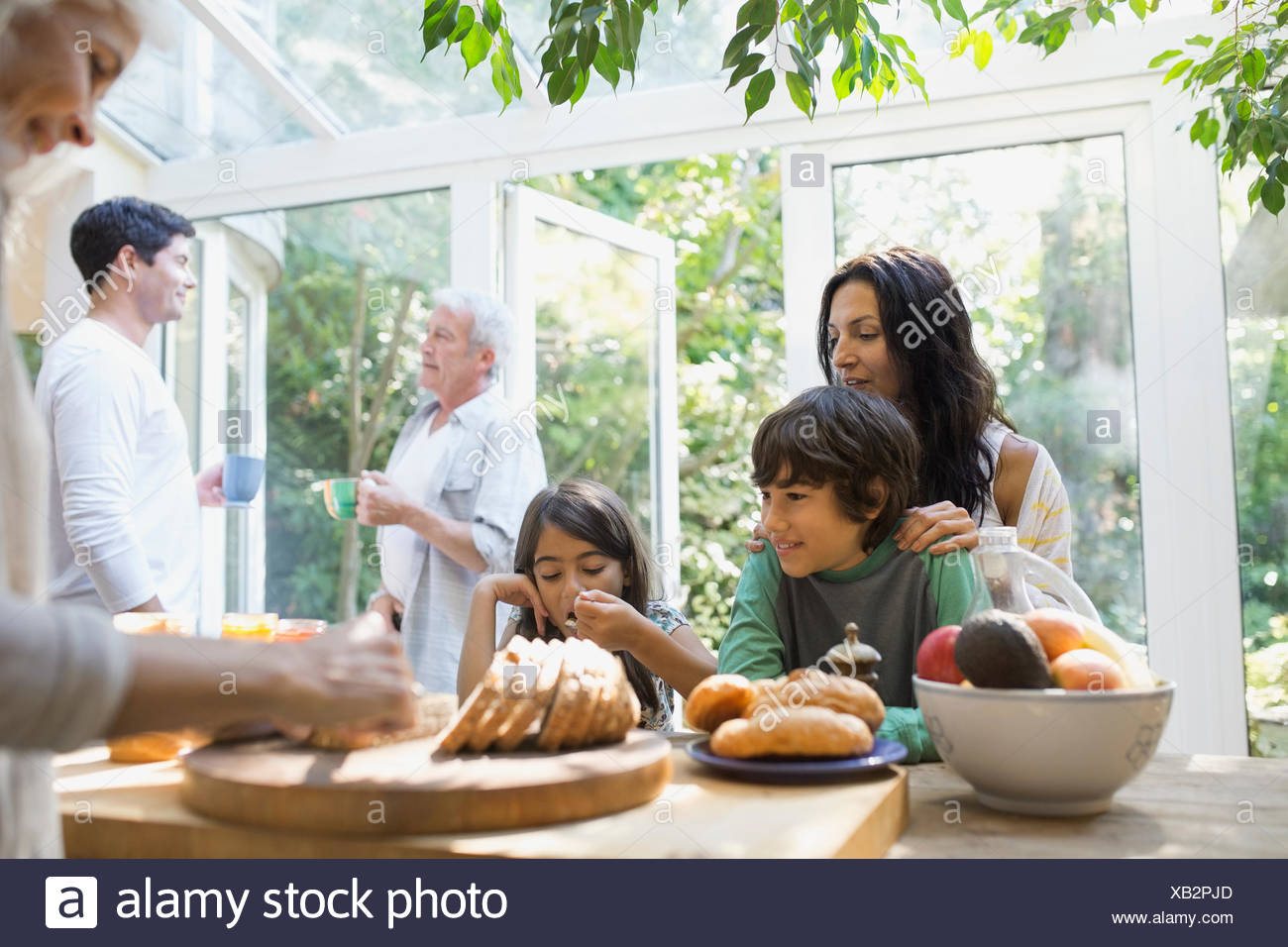 Multi-generation family eating in kitchen Stock Photo