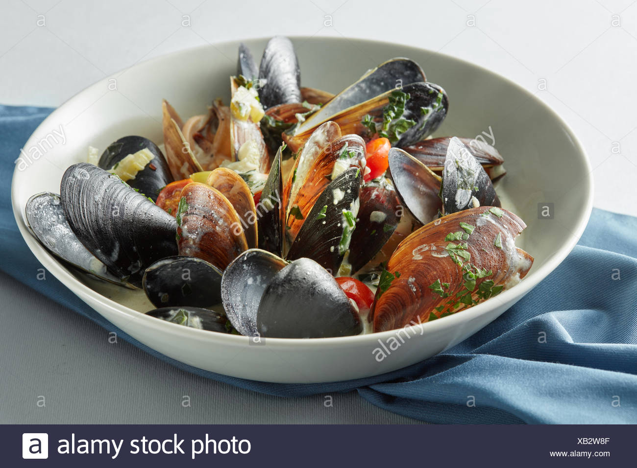 dish of mussels pics with tomato sauce - Stock Image