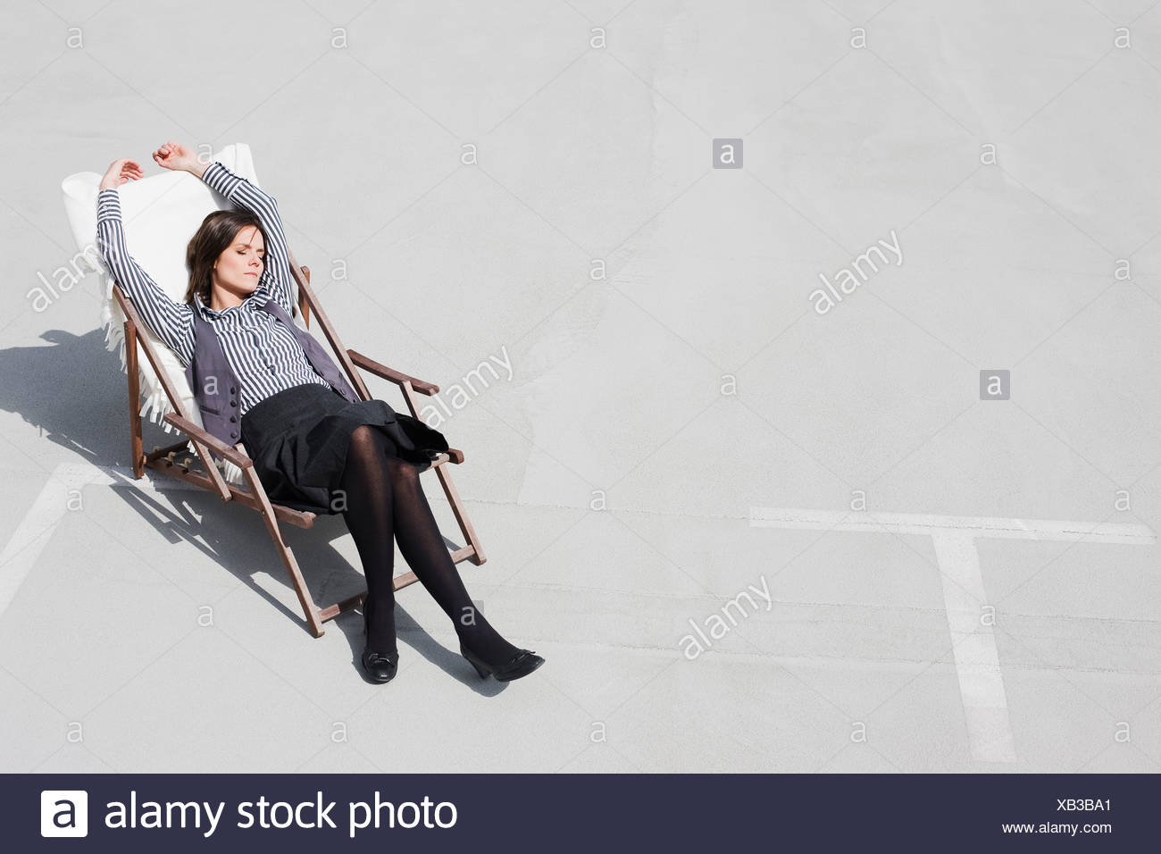 woman relaxing in deck chair - Stock Image