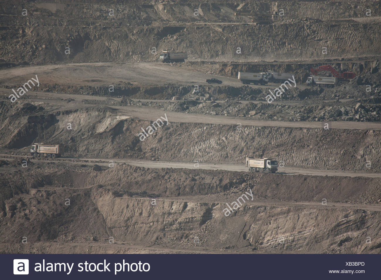 Trucks At Layers Of Opencast Mine Stock Photo