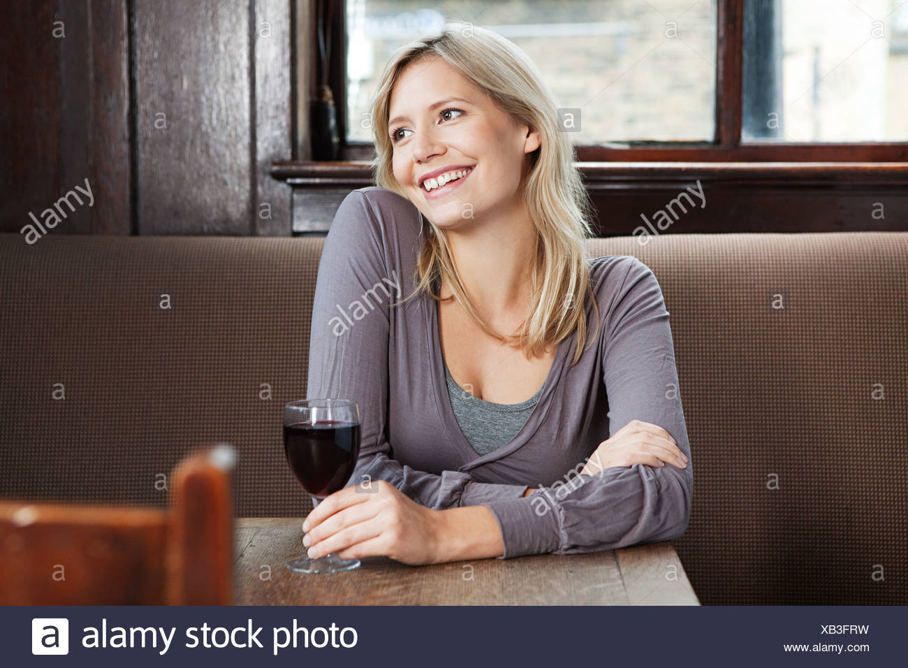 Young woman in bar - Stock Image