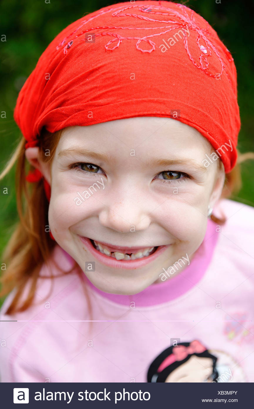 Girl with fallen out tooth and loose tooth - Stock Image