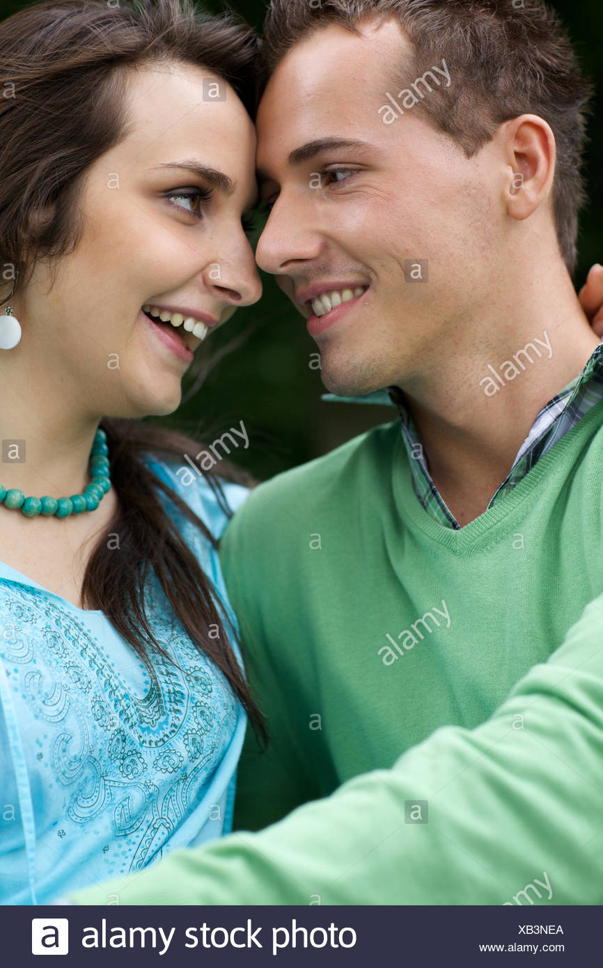 Close-up of young couple looking at each other - Stock Image