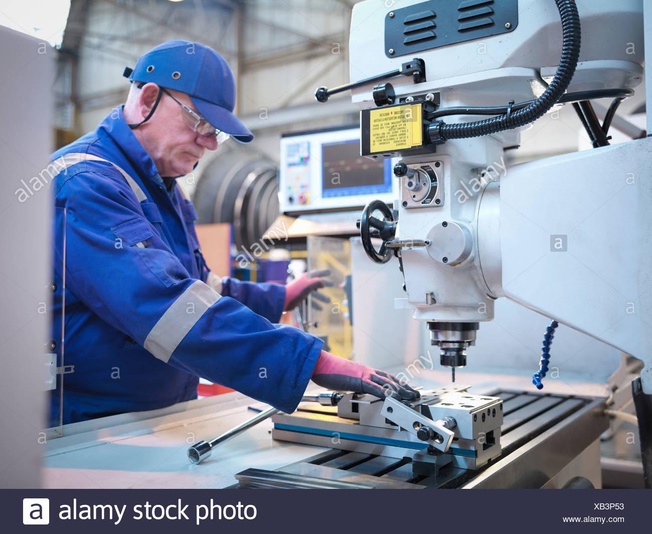 Engineer preparing lathe in steam turbine repair works - Stock Image