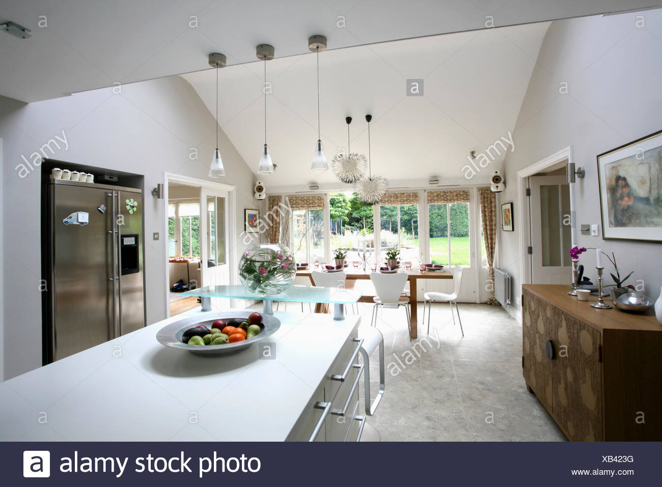 Rectangular Island Unit And Granite Flooring In Large Modern