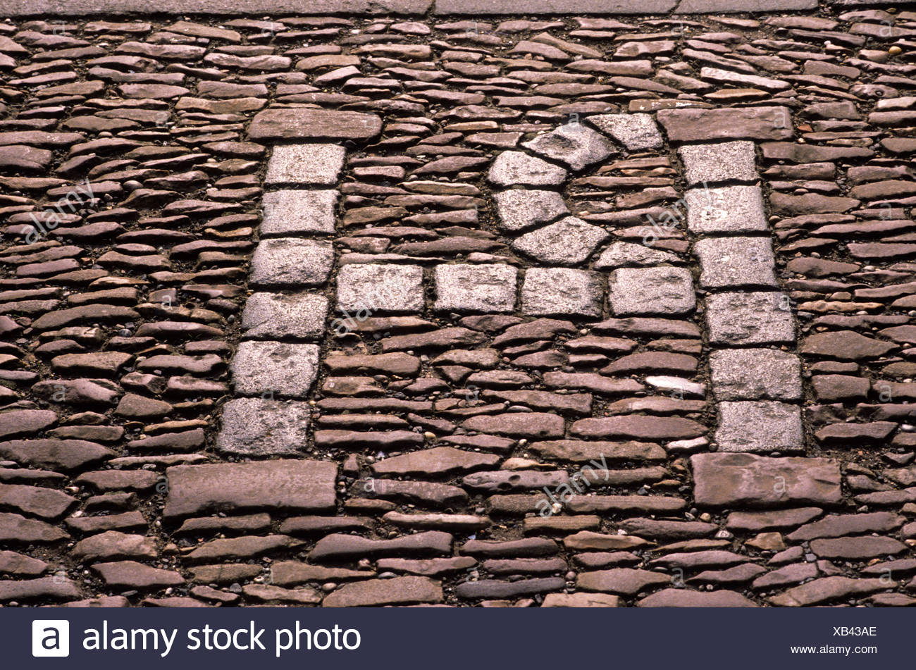 St. Andrews, Fife, Scotland, UK, initials of Patrick Hamilton on pavement, Scottish martyr, history - Stock Image