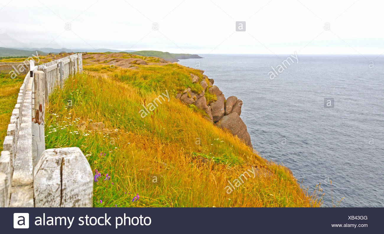 Clouds and Colors on a Coastal Cliff - Stock Image