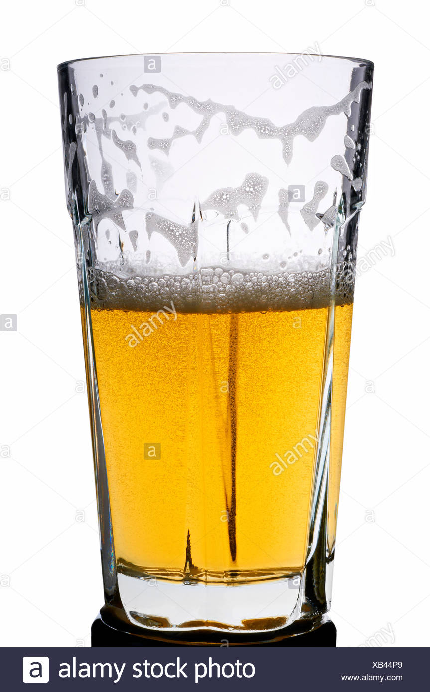 Half full beer glass with beer - Stock Image