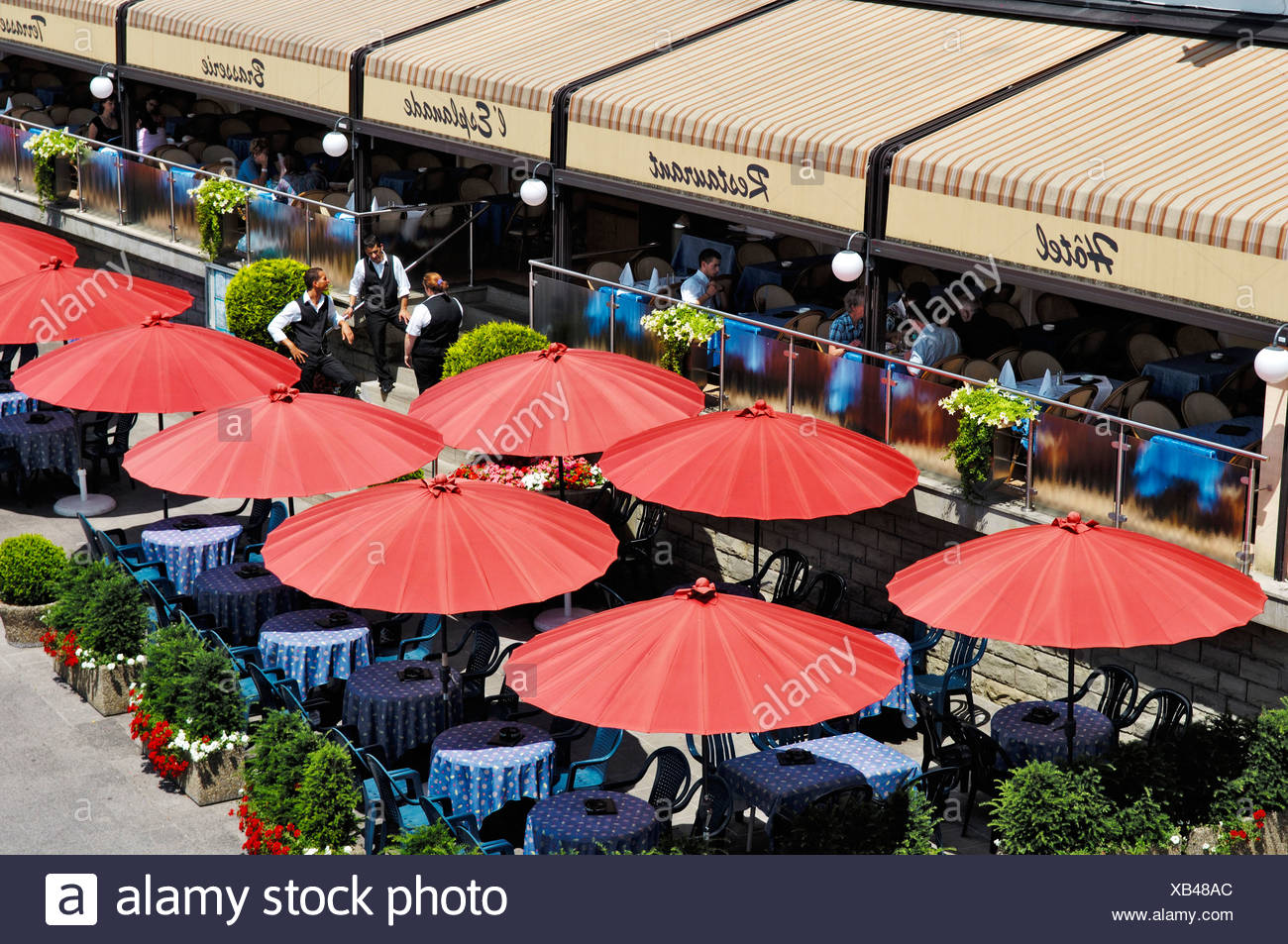 Guests in a restaurant under parasols, Luxemburg - Stock Image