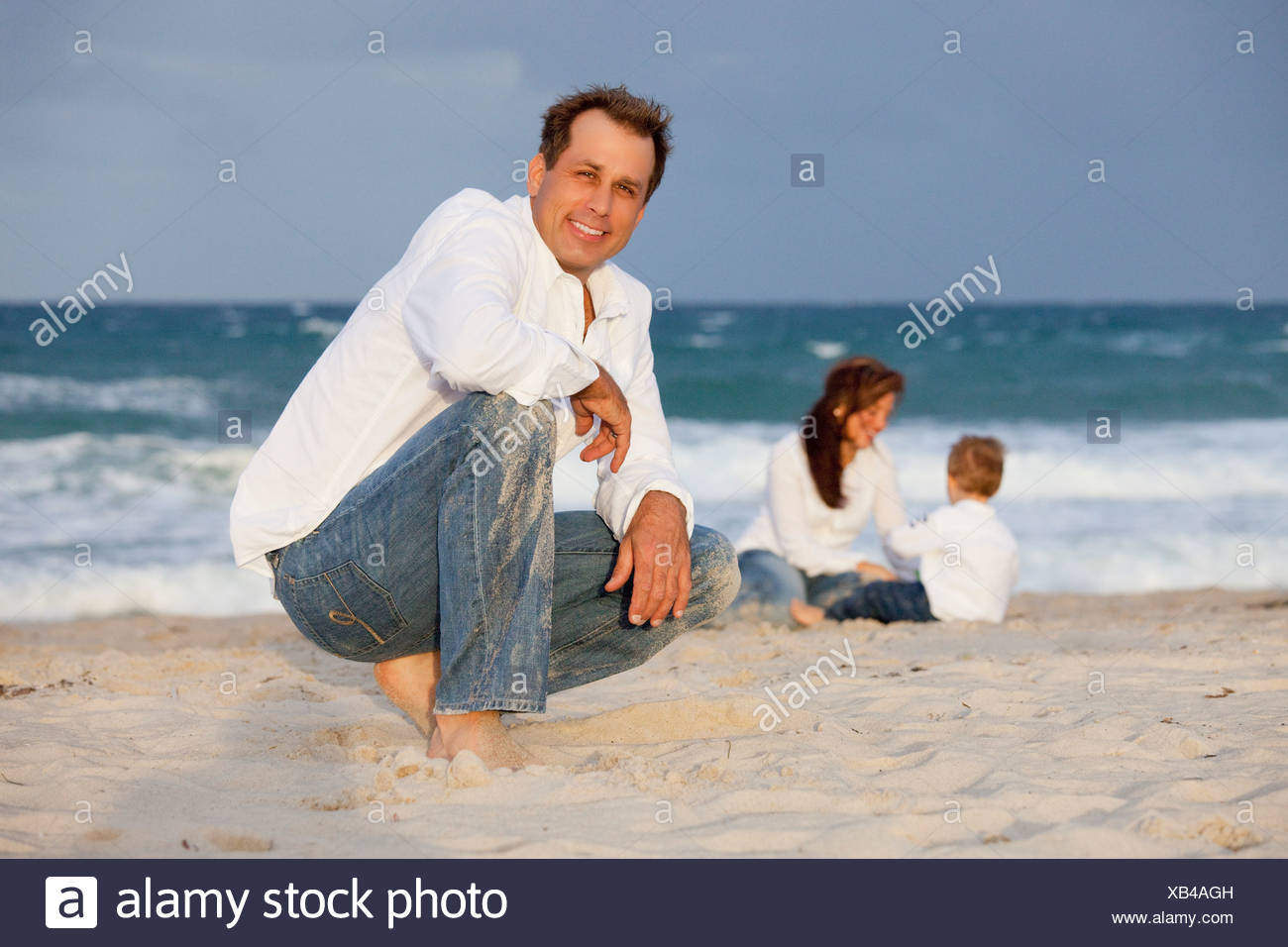 Fort Lauderdale, Florida, United States Of America; A Man On The Beach With His Family - Stock Image