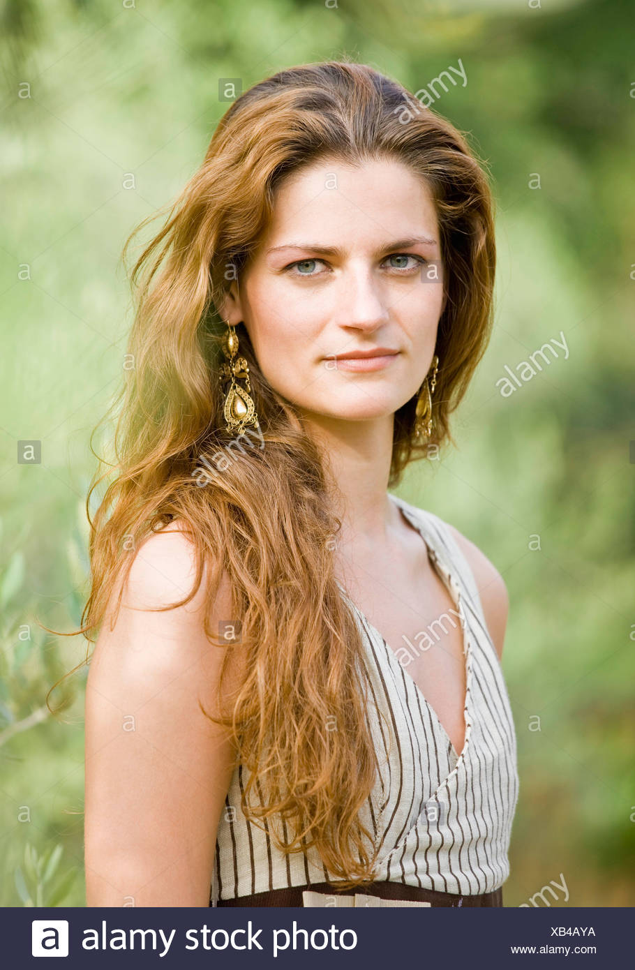 Portrait of woman in olive grove - Stock Image